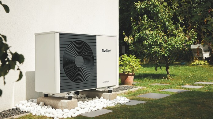 Vaillant's aroTHERM plus outside unit in a garden