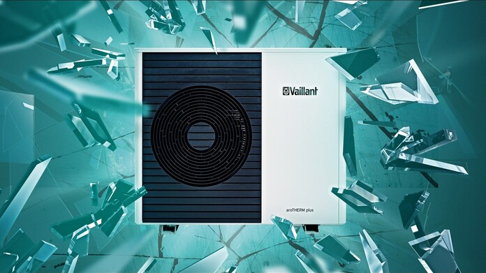 "The Vaillant aroTHERM plus air source heat pump behind shattered glass with the text ""The game changer the world needs."""