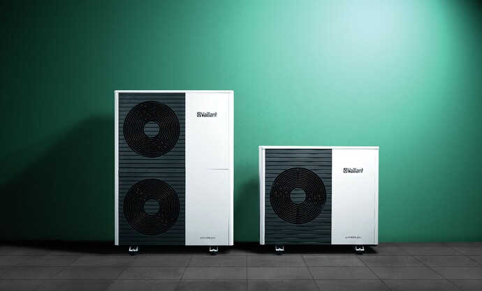 The aroTHERM plus free standing in front of a green background