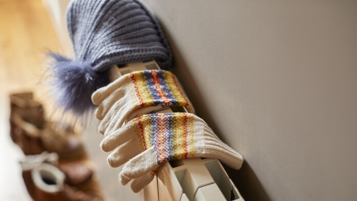 Gloves and a hat on a radiator