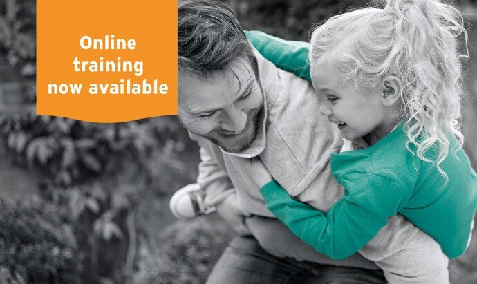 """A father playing outside with his daughter with the text """"Online training now available"""""""