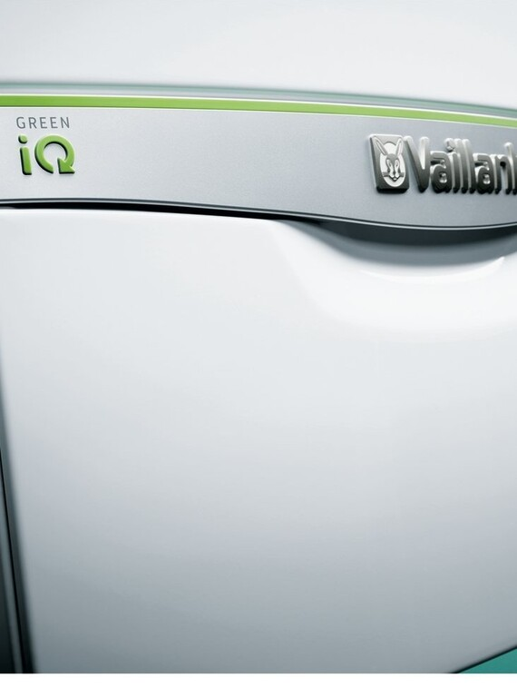Front facing ecoTEC exclusive with Green iQ with panel closed on a green background