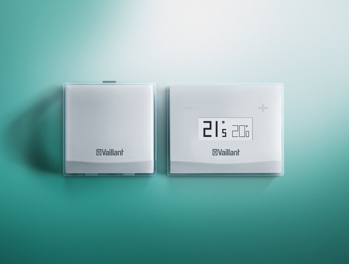 The Vaillant vSMART smart control and eBUS on a green background