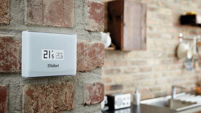 vSMART on the wall of a modern kitchen