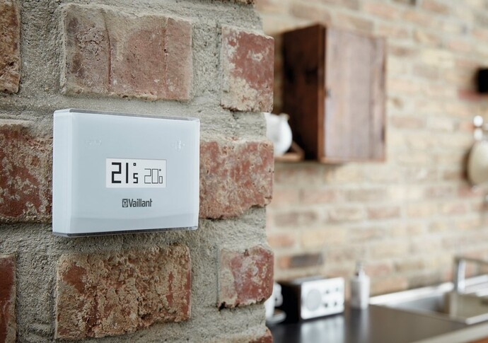vSMART smart control mounted to a wall of a modern kitchen