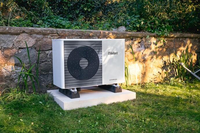 Vaillant's aroTHERM plus air source heat pump in a garden