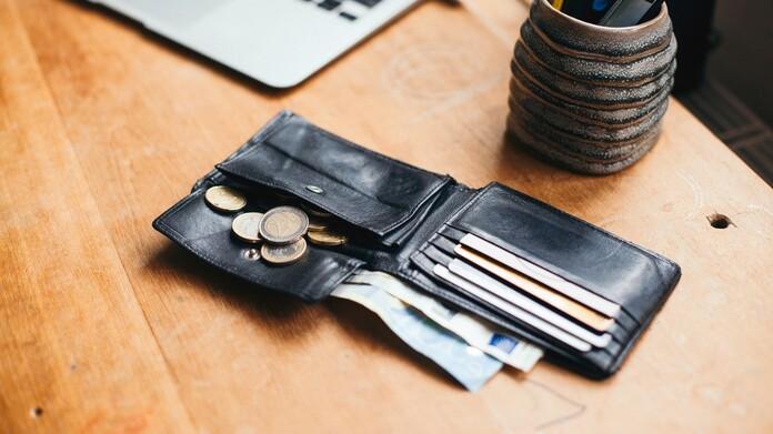 An open wallet on a desk