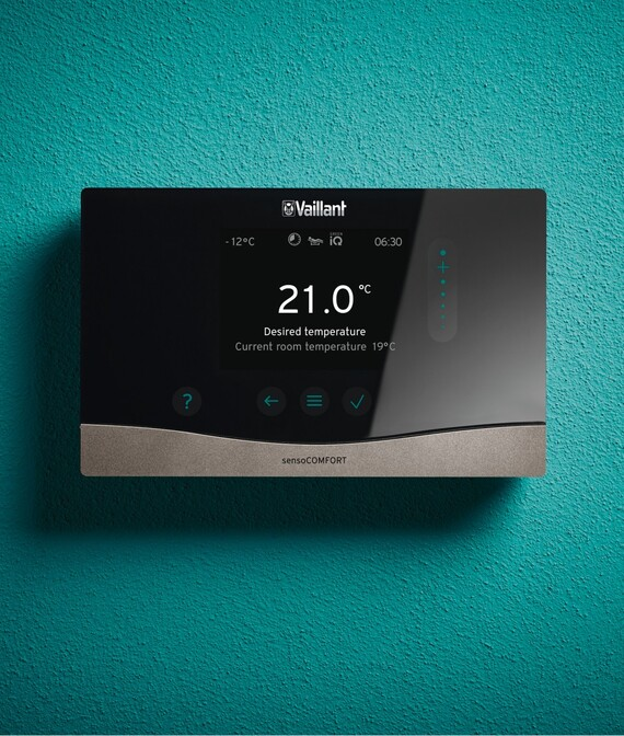 Vaillant's sensoCOMFORT heating control on a green background