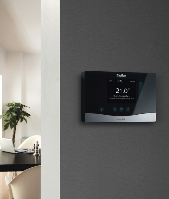 Vaillant's sensoHOME heating control on a wall of a modern home