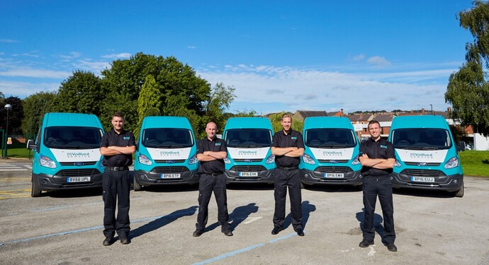 Multiple service engineers in front of Vaillant service vans