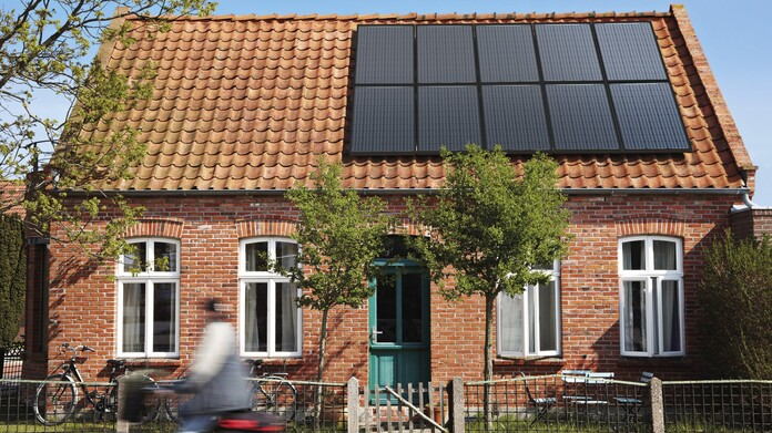 A house with a solar panel on the roof a house