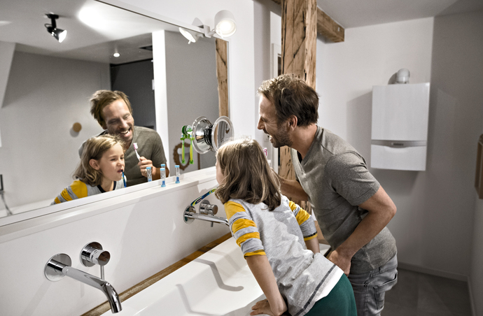 Boiler replacement - father and son brushing their teeth in the bathroom