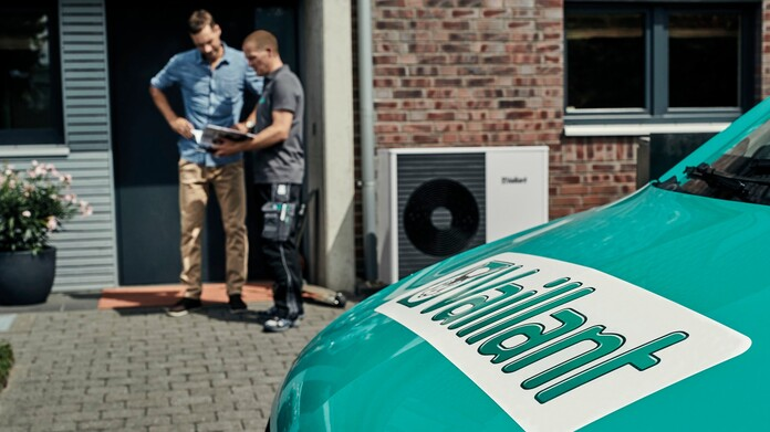 Vaillant renewables engineer talking to customer