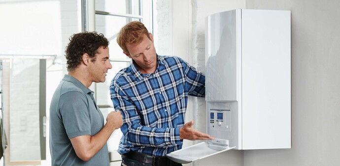 A heating engineer with a customer